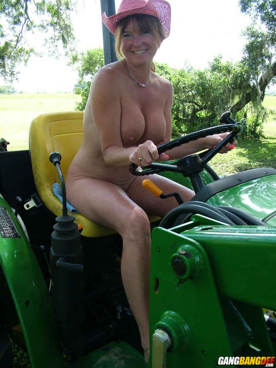 Naked milf on a tractor